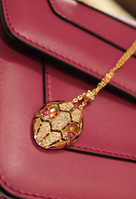 Bulgari Serpenti Seduttori gold and diamond pendant with gemstone eyes.