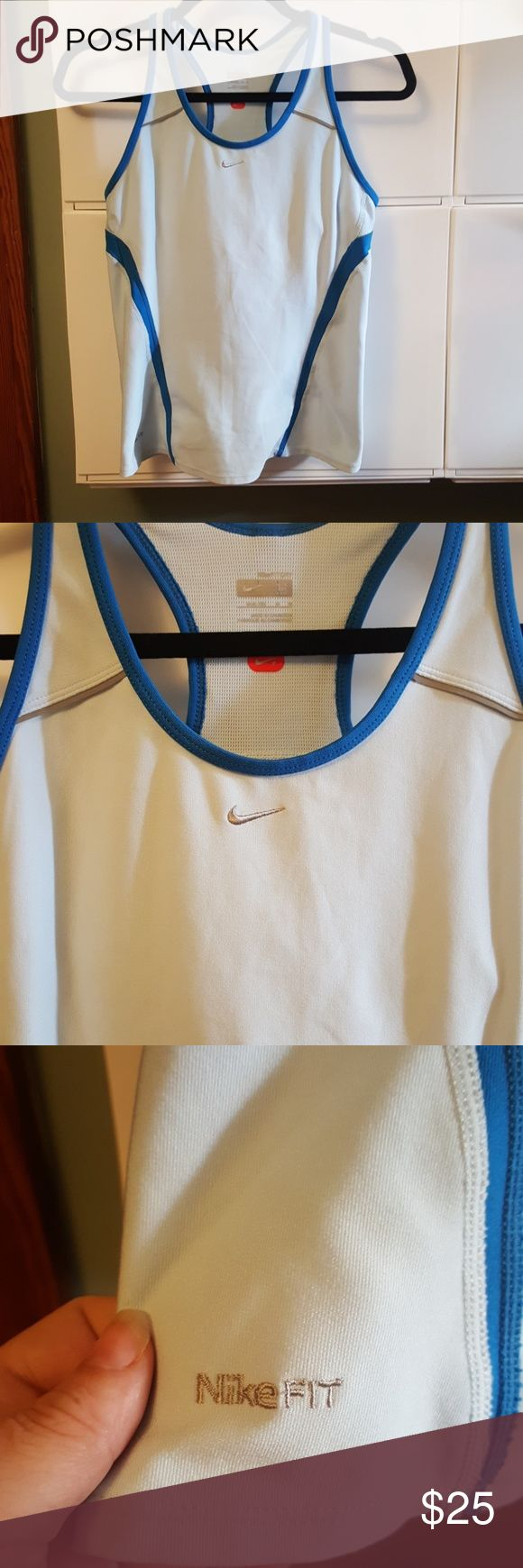 Nikefit  dry medium women's running top Nike fit dry medium women's running top features pockets in the back and racerback design also has built-in bra 92% polyester 9% spandex Nike Tops Tank Tops