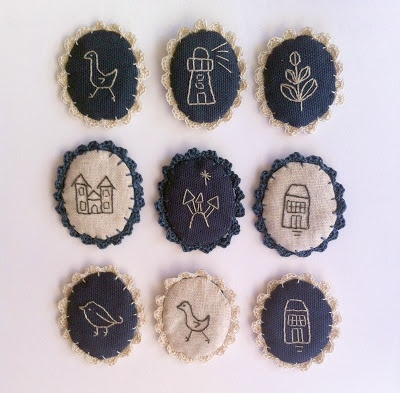 embroidered brooches, crochet edges by edward lilly