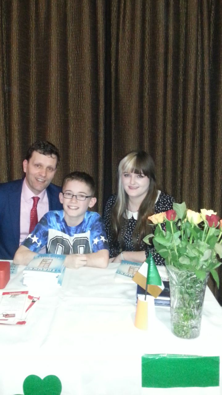 Book Hub Publishing's MD, Dr. Niall McElwee with young author, Josh Earley and Book Hub Publishing Illustrator, Chloe Vegas.