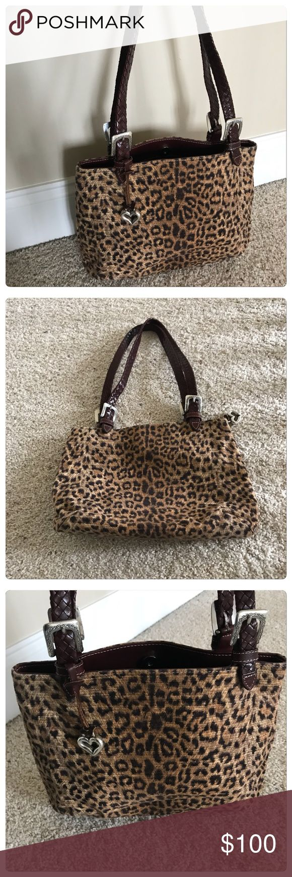 """NWOT, Brighton Cheetah Printed Purse! NWOT, Brighton Stunning Cheetah Printed Bag/Purse! Leopard/Cheetah Animal Print (Brown& Tan)Dark Brown Leather Braided Straps. Silver tone Heart Fob & Buckles. Inside side zip pockets, with center pouch. Top magnetic closure. Approx measurements: 13.5"""" L x 8.5"""" H x 5 """" D x 11"""" strap drop. Brand new in perfect condition. Comes with dust bag. No Trades Brighton Bags Shoulder Bags"""