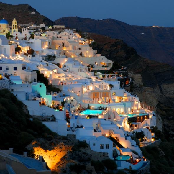 Santorini, Greece.  It truly looks like all the pictures.