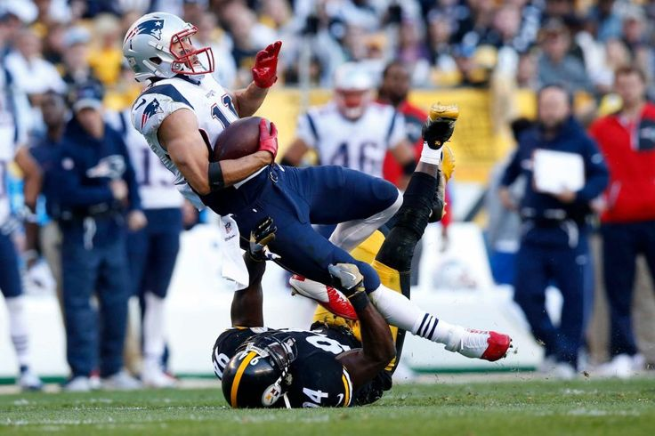 Patriots vs. Steelers:     October 23, 2016  -  27-16, Patriots  -    New England Patriots wide receiver Julian Edelman (11) is upended by Pittsburgh Steelers inside linebacker Lawrence Timmons (94) during the first half of an NFL football game in Pittsburgh, Sunday, Oct. 23, 2016.