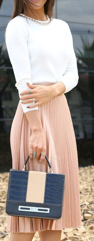 Simple summer work outfit with pleated skirt. Dressing in the summer can be tough in a hot office.