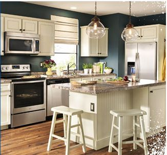 If you've got white enamel cabinets, consider a deep wall paint color like