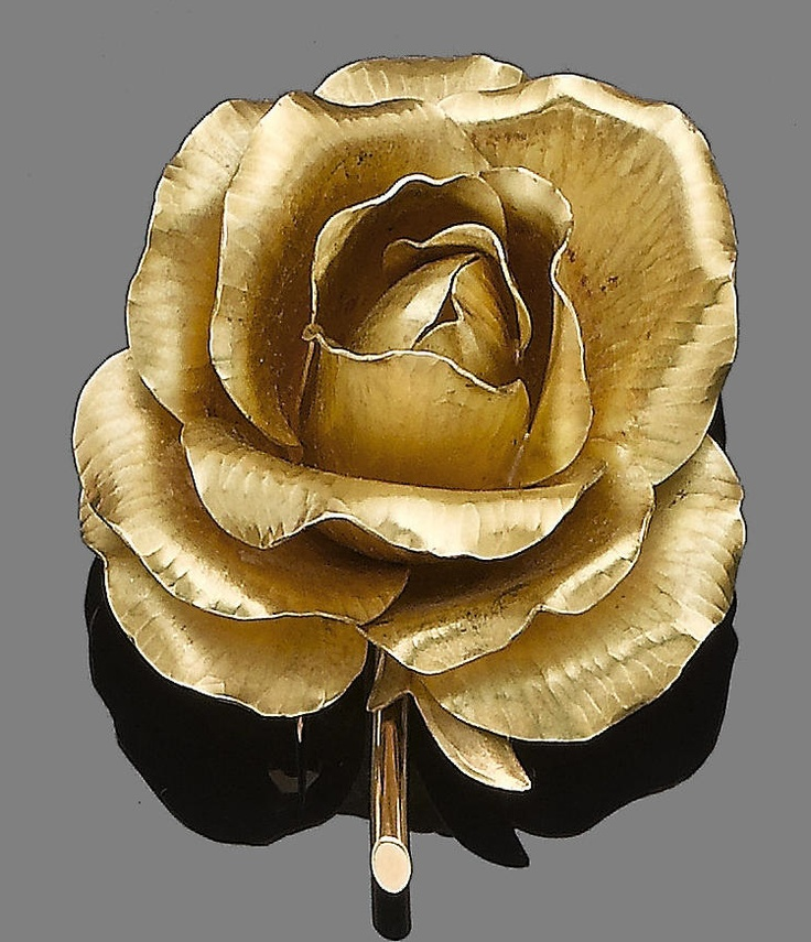A flower brooch, by #Cartier, 1958 Realistically modelled as an 18 carat gold rose with fine textured petals, signed Cartier France, numbered, maker's mark JC, partial UK hallmark, length 5.1cm, maker's case