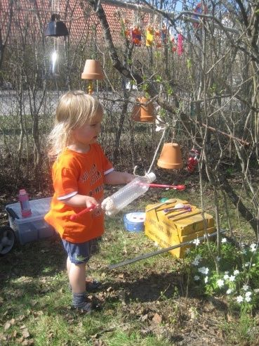 A musical tree — another good activity for the outdoor environment — kids can bring something from home for their contribution.  Many good ideas on this website