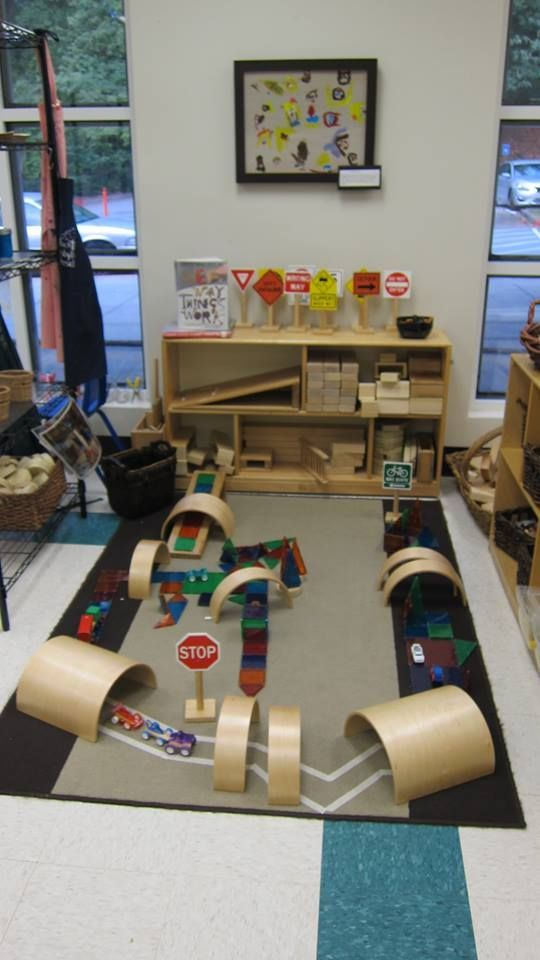 Construction play area, however I feel it not only a construction area but also having litle bit dramatic play. Children use their imagination to creat, also, there are lot of road signs, which make children to identify and understand each sigh means.