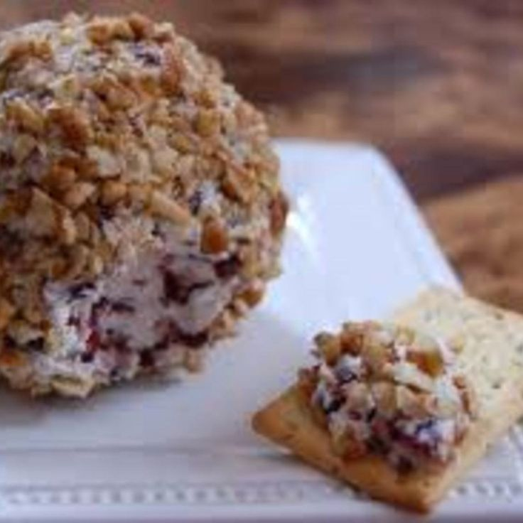 I sometimes shape this like a pinecone and layer with whole almonds during the holidays - it always gets favorable comments.  You can use any dried fruit in place of the craisins.  Serve with nice assortment of crackers like Triscuits©, Sociables©, Ritz©, or any of your favorites.