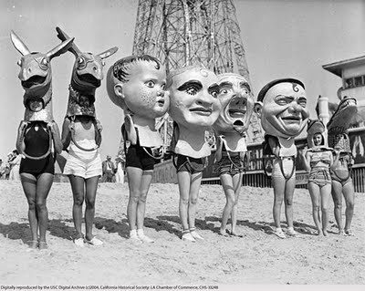 giant paper mache heads! at the beach. doesn't get much better.