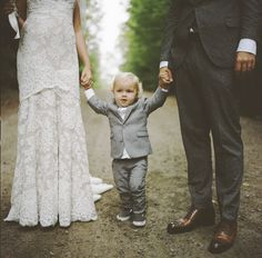 Bride  Groom with their adorable 2-year-old son | Photography: Rebecca Wood - rebeccawood.ca  Read More: http://www.stylemepretty.com/canada-weddings/2014/06/12/woodland-family-cottage-wedding/