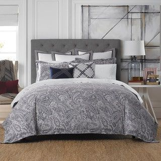crafted with a soft gray ground detailed with an elegant paisley pattern in a rich navy tone this josephine comforter set from tommy hilfiger gives any