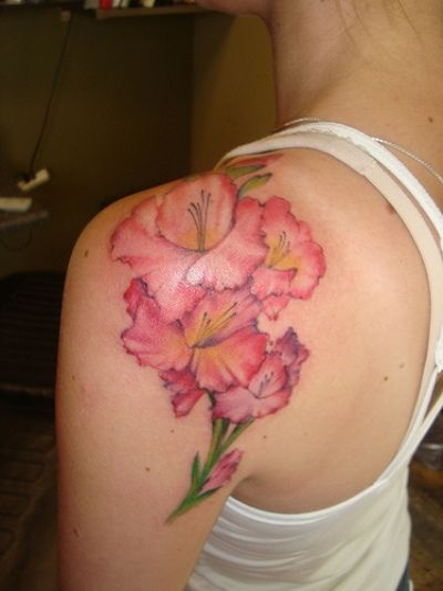 possible tattoo, August Birth Flower Tattoo | Strength and integrity gladiola flower tattoo on white singlet girl's ...
