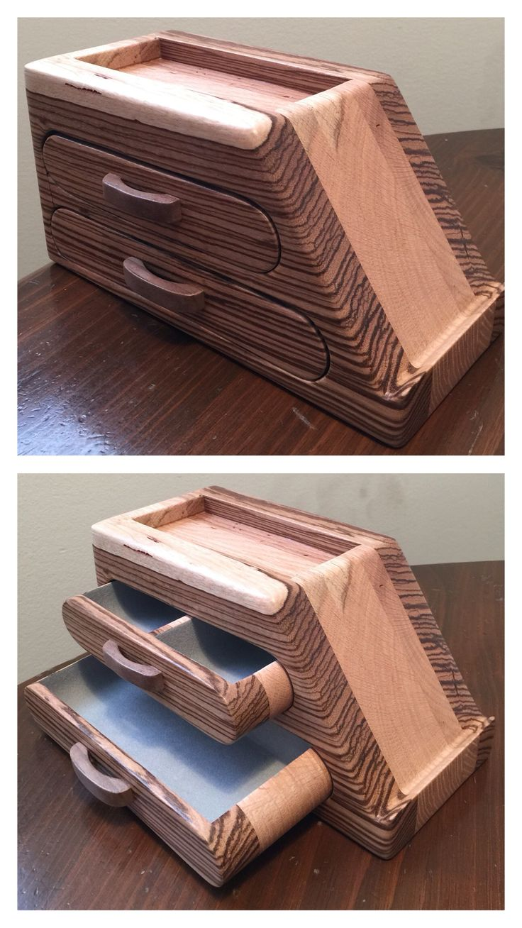 ***NOT FOR SALE*** Phone stand and bandsaw box made from zebra and reclaimed oak pallet wood with black walnut hand shaped drawer pulls. Has silver flocking in drawers.