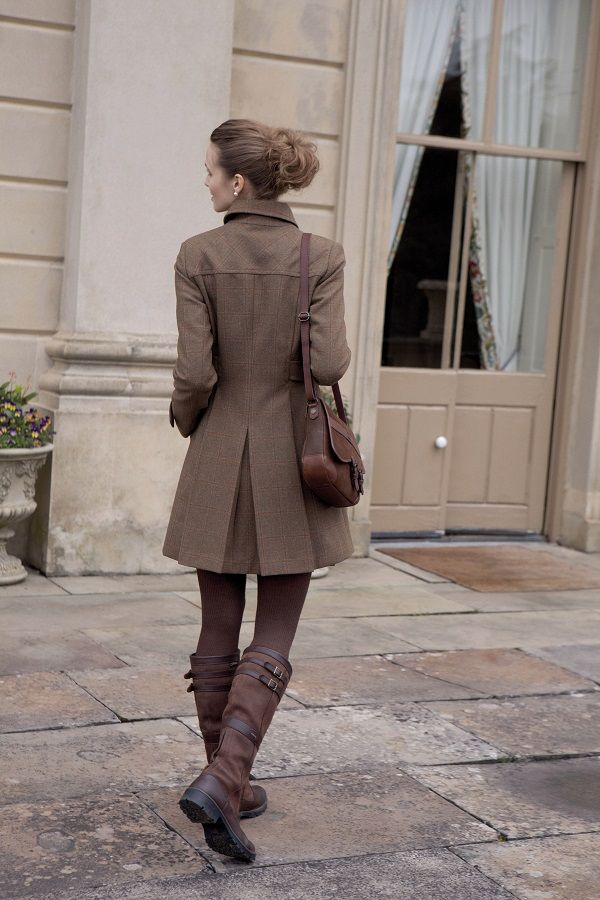 I just like the way this girl looks in the coat and boots.