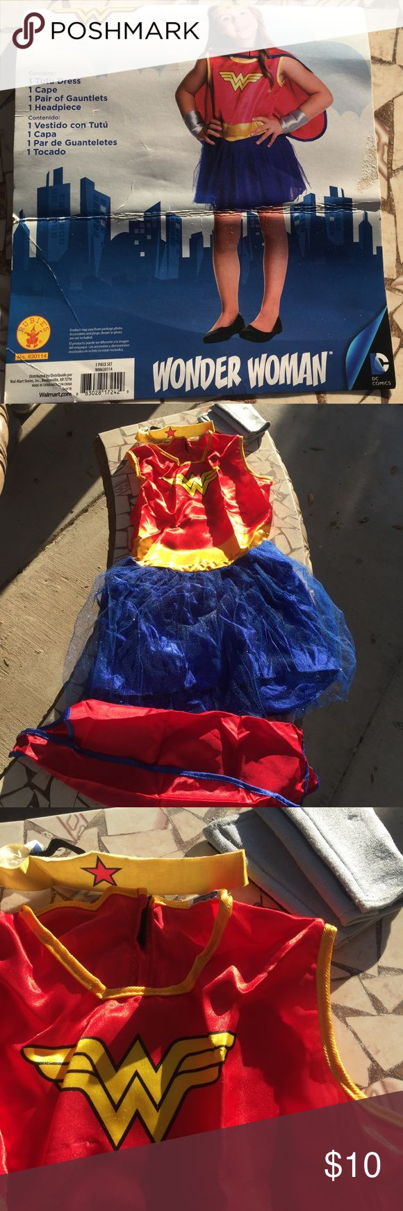 Wonder Woman girls medium Girls Wonder Woman costume size medium 8-10 comes with tutu dress, 1 cape, 1 pair of Gauntlets, 1 head piece. Worn once 🌻🎃 Costumes Halloween