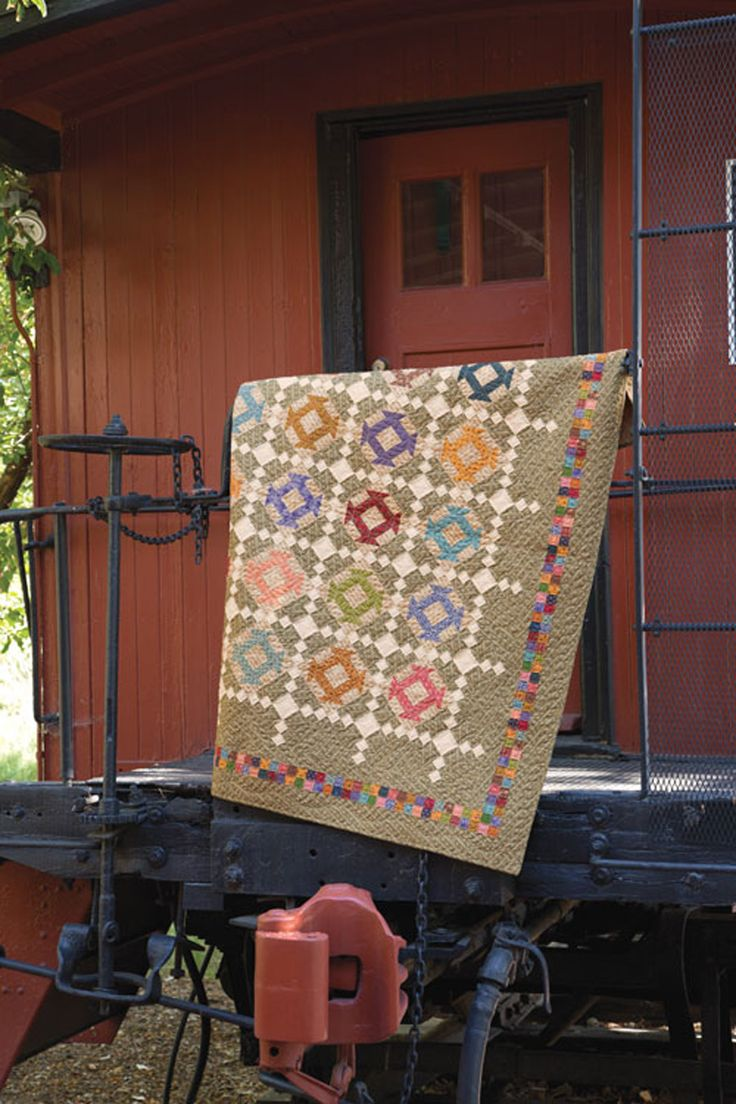 Use reproduction fabrics from your stash to create this charming scrappy throw quilt. Design by Deanne Eisenman and featured in Quiltmaker Nov/Dec 16'
