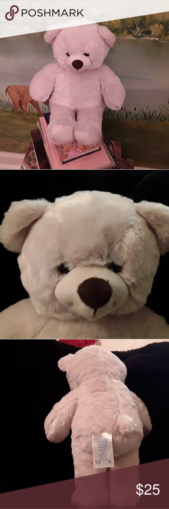 """NEW CUDLIE BUILD A BEAR WORKSHOP BEAR, CREAM I HAVE FOR SALE A NEW DARLING CUDLIE SOFT BEAR FROM BUILD A BEAR WORKSHOP.  IT IS CREAM IN COLOR AND HAS THE """"BABY"""" LOGO ON RIGHT PAW.  THE BEAR IS 10.5 """" X 11"""".  THIS WOULD MAKE A GREAT GREAT FOR YOUR LITTLE ONE, YOU CAN TAKE IT TO A STORE NEAR YOU AND MAKE IT ONE OF A KIND BY YOUR IMAGINATION.  IF YOU HAVE ANY QUESTIONS ABOUT THIS BEAR PLEASE ASK AND THANK YOU FOR YOUR SHOPPING MY CLOSET. Build a Bear Workshop Other"""