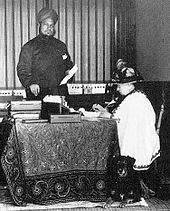 "Queen Victoria at her desk, assisted by Abdul Karim in 1885  Diaries reveal Queen Victoria's affection for her 'Indian John Brown' For more than a century, Munshi Abdul Karim was derided as a jumped-up servant who refused to know his place in Queen Victoria's household. ""racial prejudice"" http://www.telegraph.co.uk/news/worldnews/asia/india/7528522/Diaries-reveal-Queen-Victorias-affection-for-her-Indian-John-Brown.html"