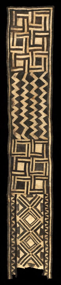 Africa | Woman's Ceremonial Skirt from the Bushong people of DR Congo | ca. early 20th century | Pounded and dyed inner bark (Ficus); piecing | This striking wraparound skirt was made for an aristocratic woman of the Bushong ruling group, possibly a member of the royal clan, since they were the only Kuba who were entitled to wear barkcloth, which was otherwise restricted to mourning and funerary rite.