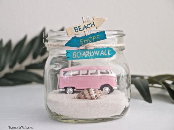 Its the beach in a mason jar! This adorable Beach Car In A Jar is a completely original design by BeachBlues. As of January, 2017, this is the only design of its kind. These make ideal gifts and centerpieces for that beach lover in your life.  This listing includes 1 PINK VW Bus, 1 clear pint jar of your choice (regular mouth pint or wide mouth pint), sand, beach sign, small shell (various), twine, lid.  You can arrange it however you want. Tilt the jar on its side or leave it standing…