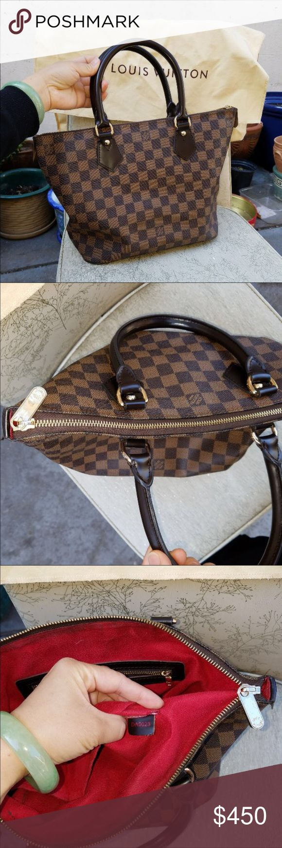 Authentic Louis vuitton purse Authentic Louis Vuitton purse outside is in excellent condition and inside has a couple dark spots.  Overall a great bag. Looking to trade!  Cannot locate dustbag think it was taken off to goodwill by accident! Louis Vuitton Bags Shoulder Bags