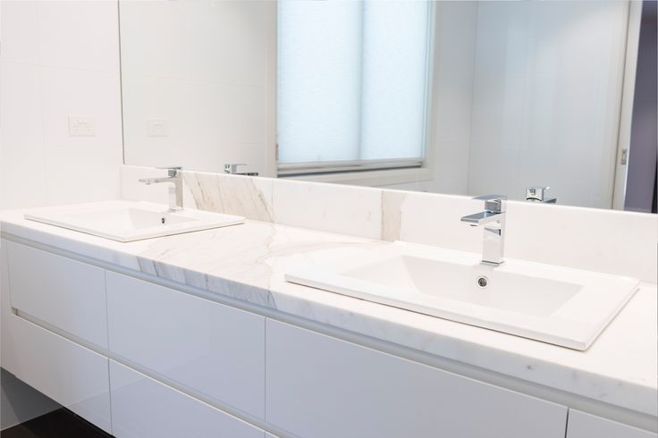 Elegant and stylish bathroom design, features wall hung vanity for the ensuite with marble benchtop.