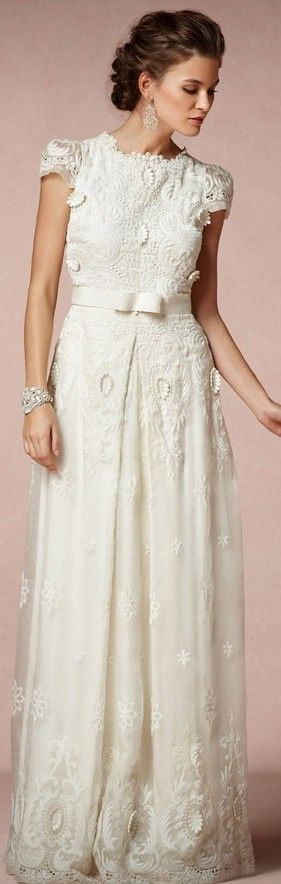 I love this dress! :) I have a soft spot for cap sleeves and lace!  ..............................  Rococo Gown $3,600.00 Modest Wedding Gown An exquisite affair of meticulous floral embroidery and intricate cutwork, designed by Collette Dinnigan. Clean lines, crisp cap sleeves, and a single box pleat at the waist sharpen the understated elegance of a throwback silhouette fashioned from ivory organza. Exclusive to BHLDN.