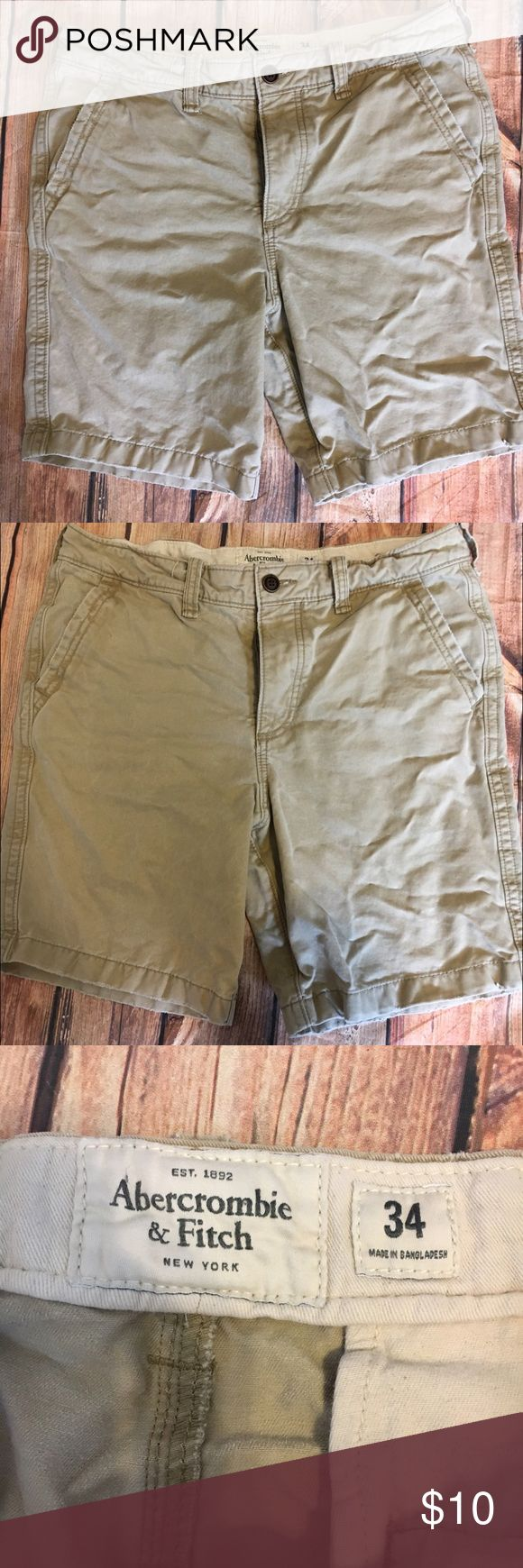 Abercrombie men's khaki shorts size 34 Abercrombie size 34 khaki shorts. Intentionally distressed. Please note before purchase that there is intentional distressing. Button fly. Previously worn condition. Abercrombie & Fitch Shorts