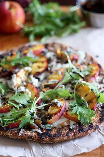 grilled whole wheat pizza with peaches, blue cheese, toasted walnuts, sage, arugula, and balsamic