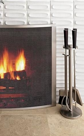 Crate and Barrel Curved Fireplace Screen/Tools with Shesham Handles Sleek fireplace accessories combine the strength of metal with the elegant look of brushed silver. Pewter-finished steel and mesh screen floats in a modern elliptical base. Handcrafted brushed steel tools are topped with solid shesham wood handles for striking contrast. Prices range from $159.00 to $179.00