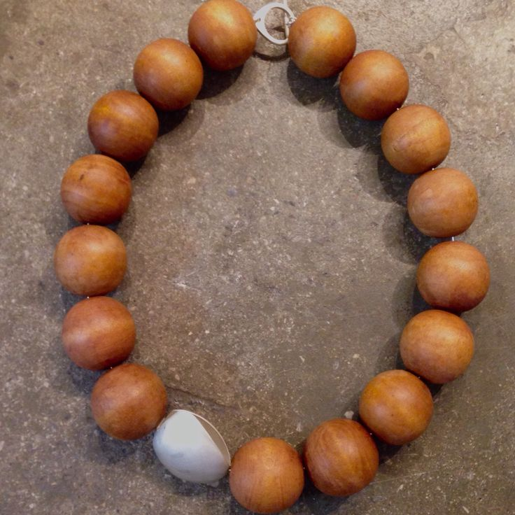 Necklace. Beautiful and bold. Large hand crafted ball pieces in sandalwood with a sterling silver detail and clasp. Made by Jenny Geeco