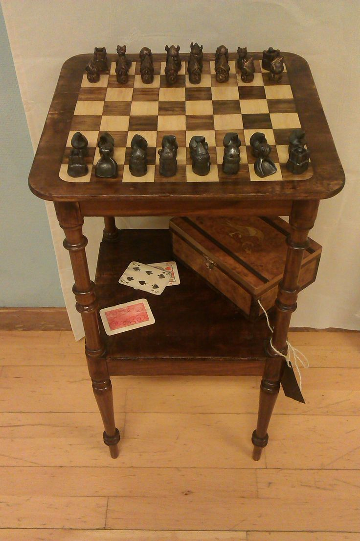 Chessboard with painted intarsia and deck of card. Viking chessman in ceramic.
