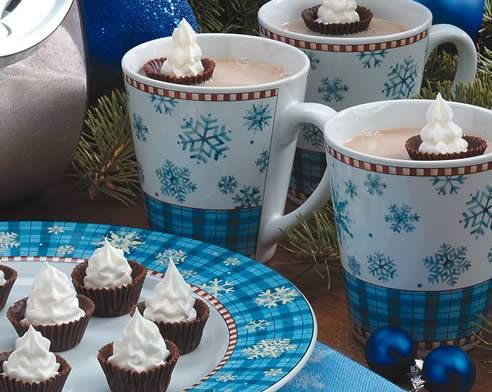 Whipped cream floating in chocolate cups - pretty!
