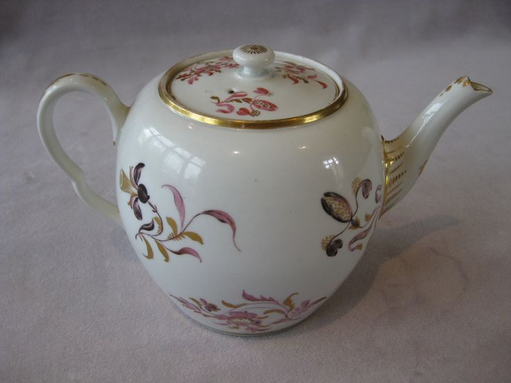 """A Worcester tea pot with a button knop and a shaped handle. painted with a rare pattern with pink and gilt flowers and sprays and gilt decoration to rims, handle & spout. Unmarked   Circa  1780 Height 5 1/4"""""""