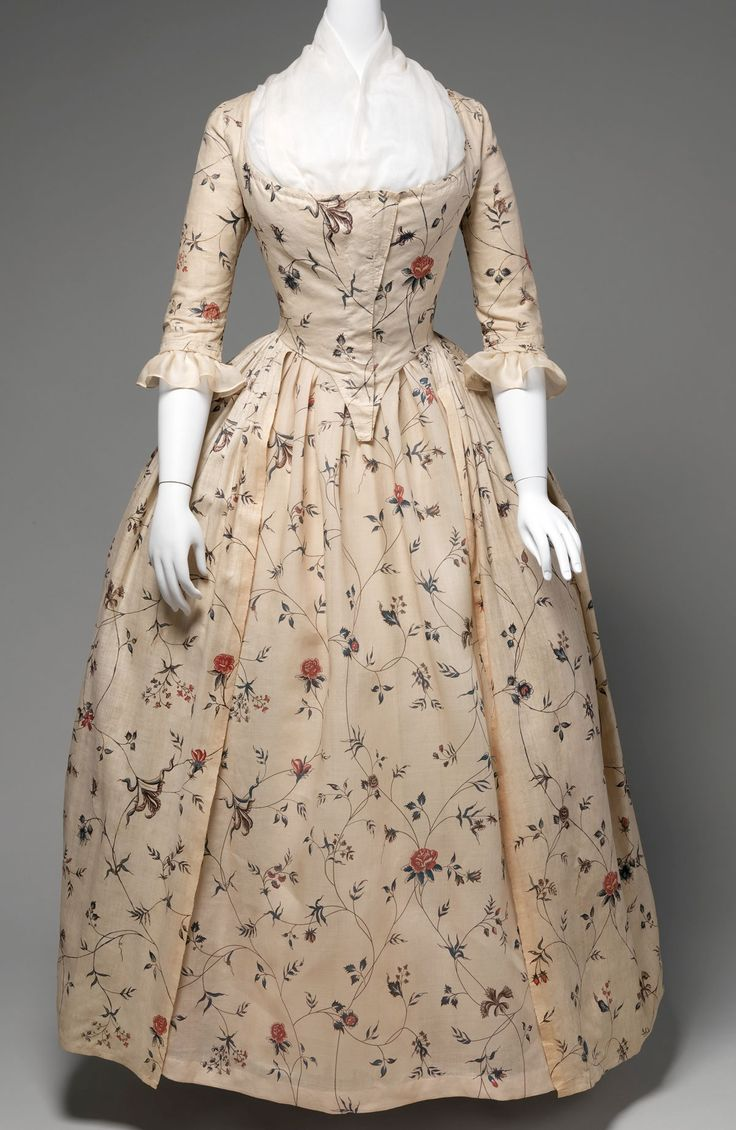 Robe à l'Anglaise, 1785–95, American, cotton, baleen. The robe à l'anglaise developed with a fitted back after the style of dress worn in England. The silhouette, composed of a funnel-shaped bust feeding into wide rectangular skirts, was inspired by Spanish designs of the previous century and allowed for expansive amounts of textiles with delicate Rococo curvilinear decoration.  The Met