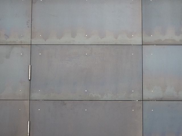 Hot rolled steel panels beach house fireplace
