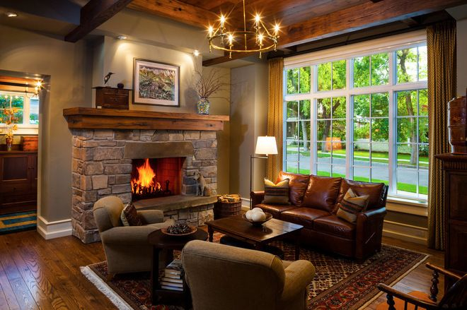 Formal lounge with large fire place and big window. craftsman living room by Locati Architects