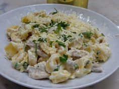 Τορτελίνια με βότκα μανιτάρια και κρέμα.