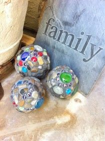 Garden Balls using styrofoam balls, grout, glue, stones, and various sized flat backed glass pieces