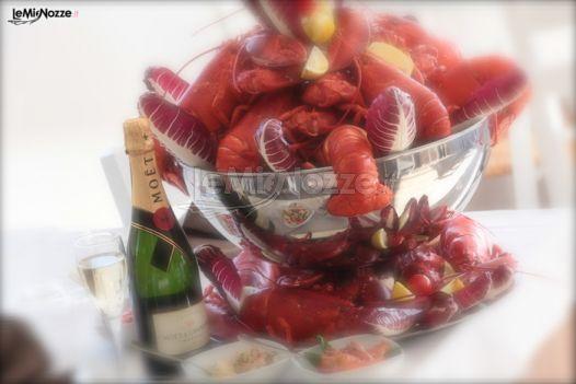 http://www.lemienozze.it/operatori-matrimonio/luoghi_per_il_ricevimento/le-terrazze-sul-lago/media/foto/24 Pesce crudo e champagne per il banchetto nuziale.