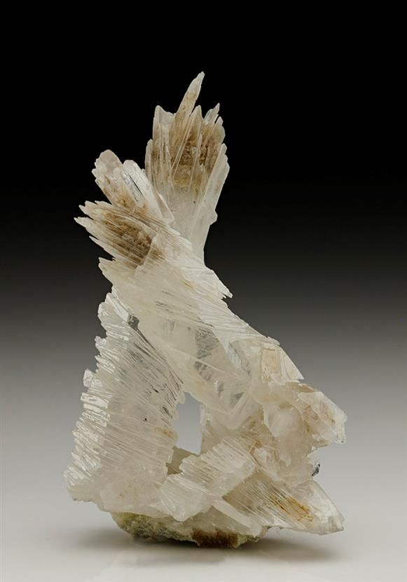 A curiously fascinating specimen of Quartz from Jinlong Hill, China. Essentially two crossed crystals of prismatic colourless-white Quartz measuring to 6.4cm, display a segmented slipped-disc and outgrowth-rehealed habit.