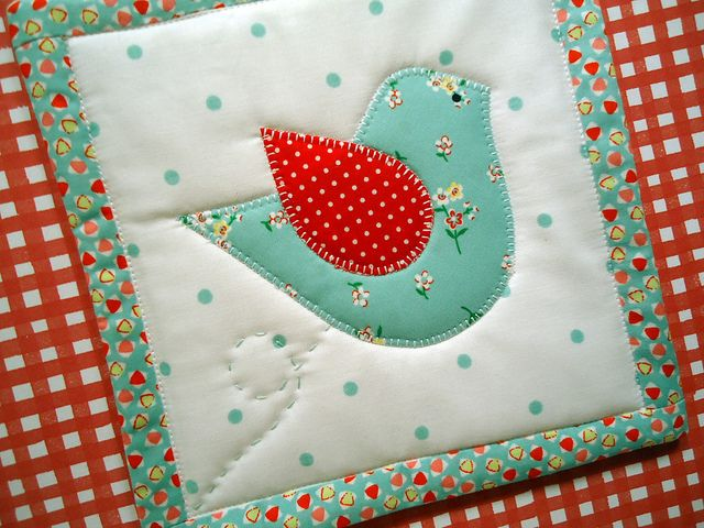 Potholder #2 in funky retro colors/prints of aqua with a splash of red.