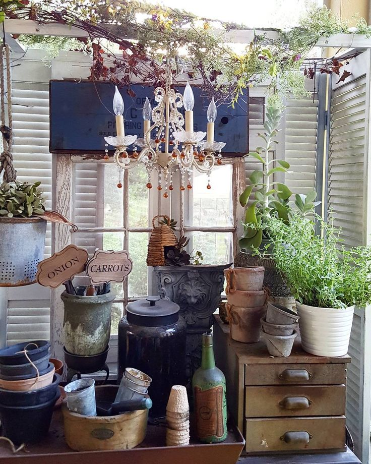 Rustic glam farmhouse potting bench, garden on the back porch. Old shutters, vintage Windows, antique chandelier, concrete architecture pots and more. Easy DIY Country Living @beesnburlap on Instagram