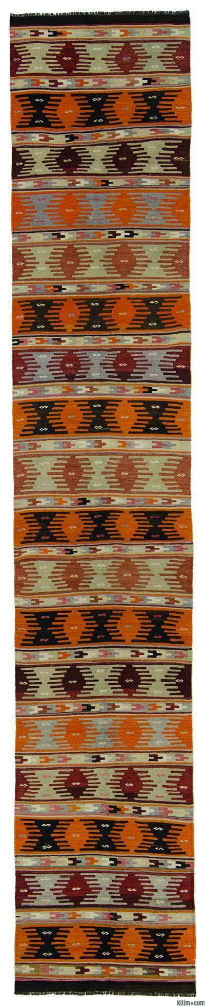 Vintage tribal Turkish kilim runner rug around 60 years old and in very good condition. This long kilim runner was hand-woven in the Sivas region of Central Anatolia, Turkey.
