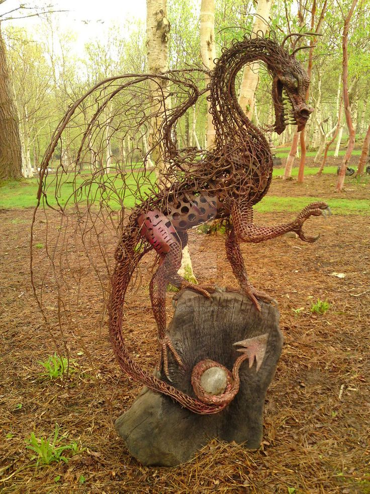 Dragon by Matt Cummings. Mixed metals, epoxy putty, glass, oak, rubber. Dimensions:200cm high