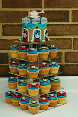 This is 3 dozen cupcakes with a buttercream iced cake with all fondant accents. (Helicopter is a toy)   The helicopter, Harold, is a...