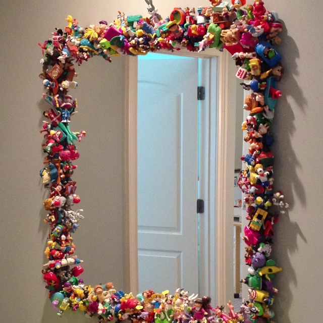 A great use for all those plastic toys in a Happy Meal. Glue to a frame. Serious…