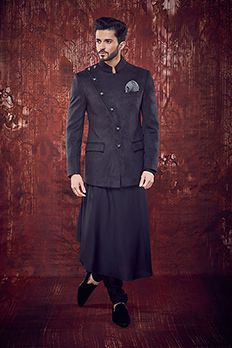 Suede achkan style jodhpur highlighted with show buttons paired with flare long kurta and silk churidar