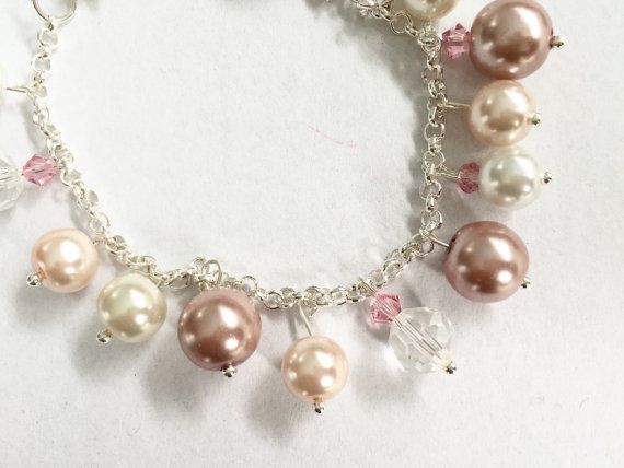 Silver bracelet with vintage rose, peach, ivory and white pearls.